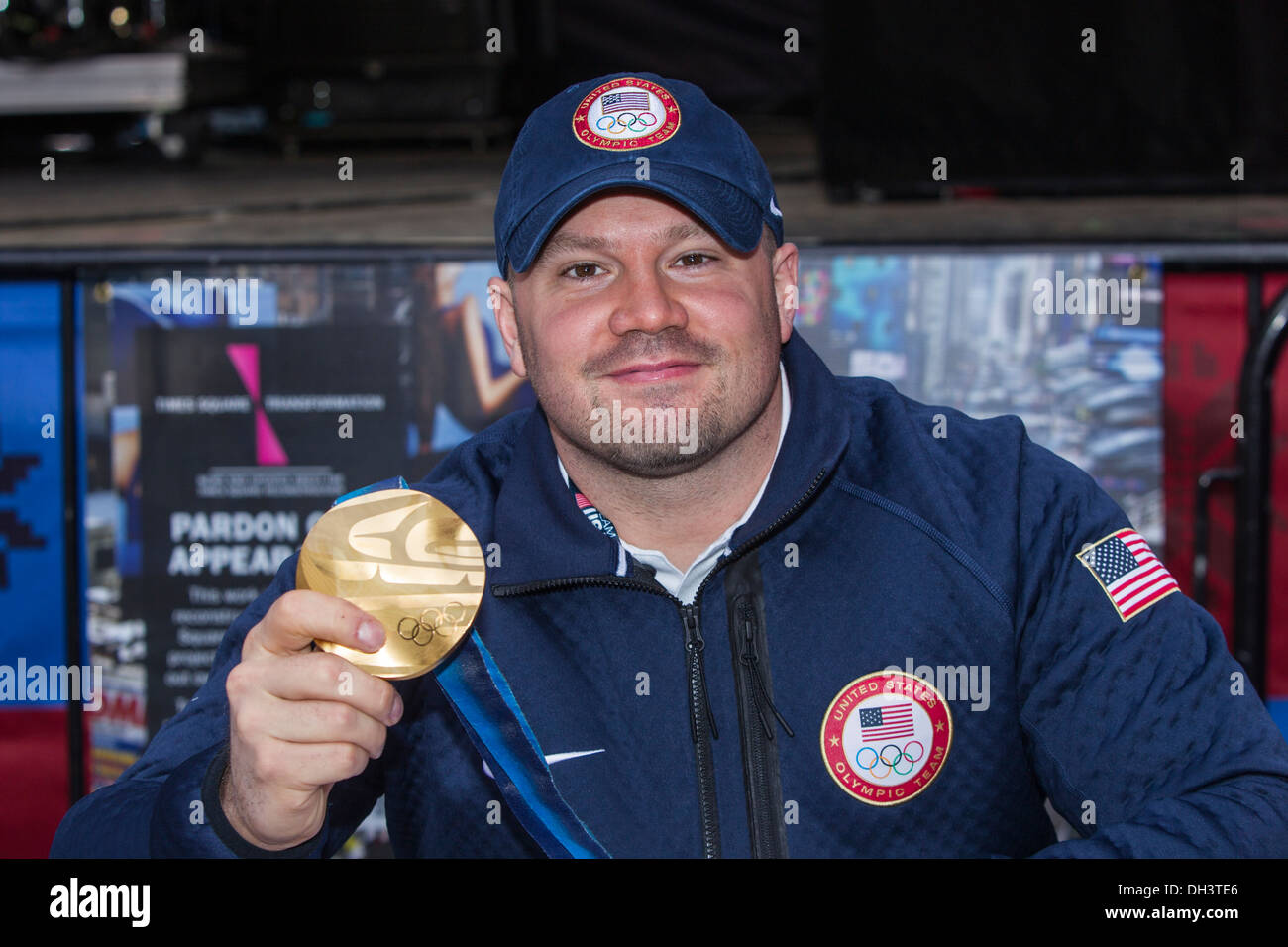 Steve Holcomb showing off his gold medal from the 2010 Olympics at the USOC 100 Day Countdown to the Sochi - Stock Image