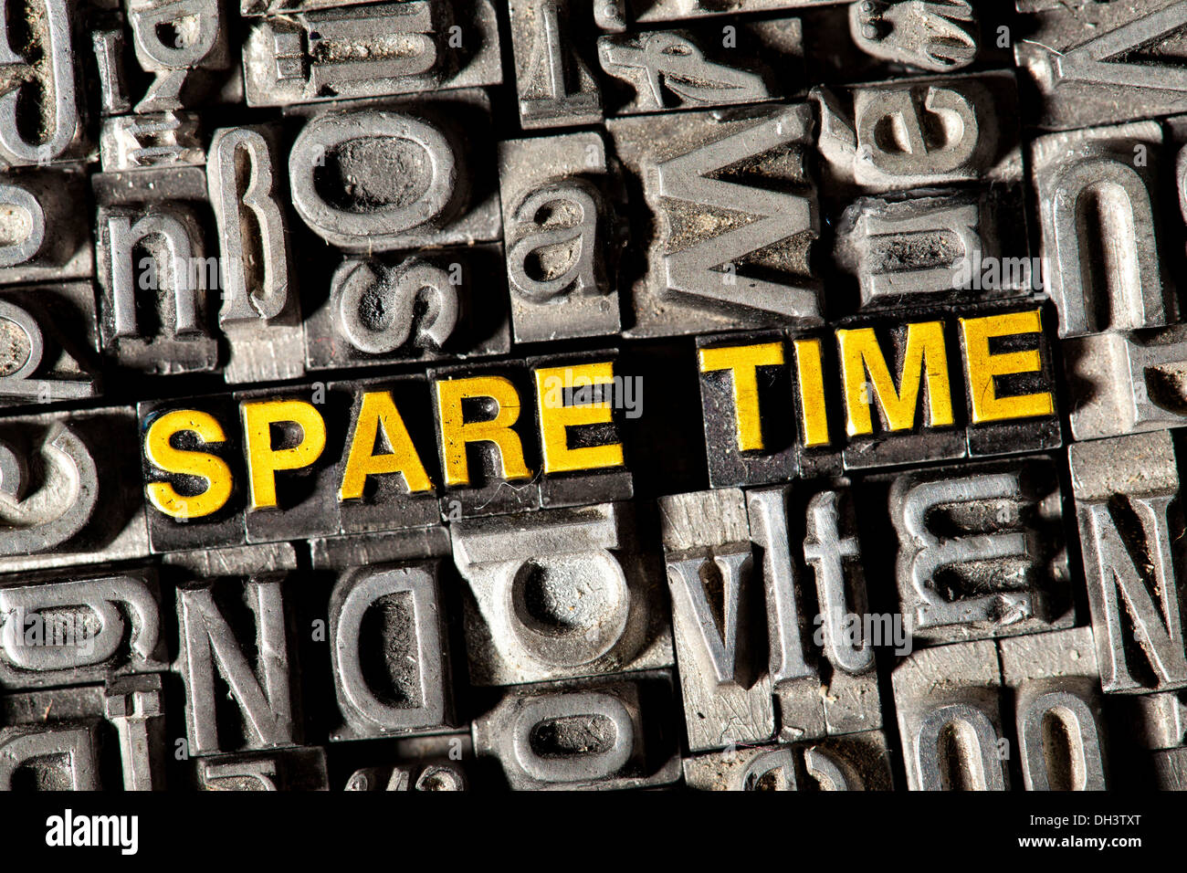 Old lead letters forming the words 'SPARE TIME' - Stock Image