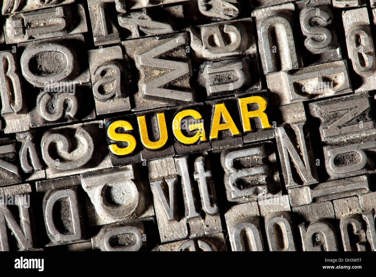 Old lead letters forming the word 'SUGAR' - Stock Image