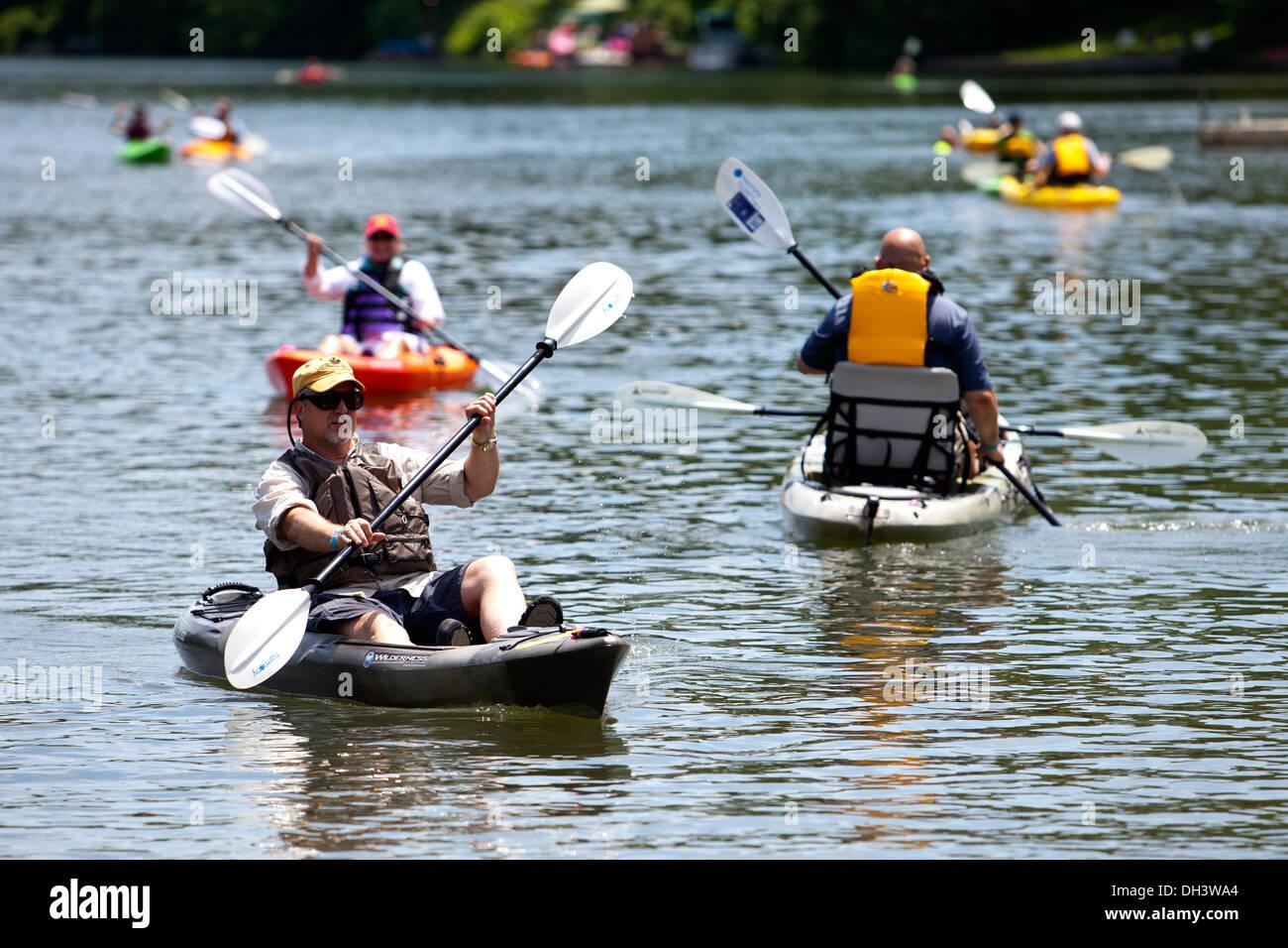 Kayakers paddling on a lake in Bella Vista, Arkansas, USA. Stock Photo