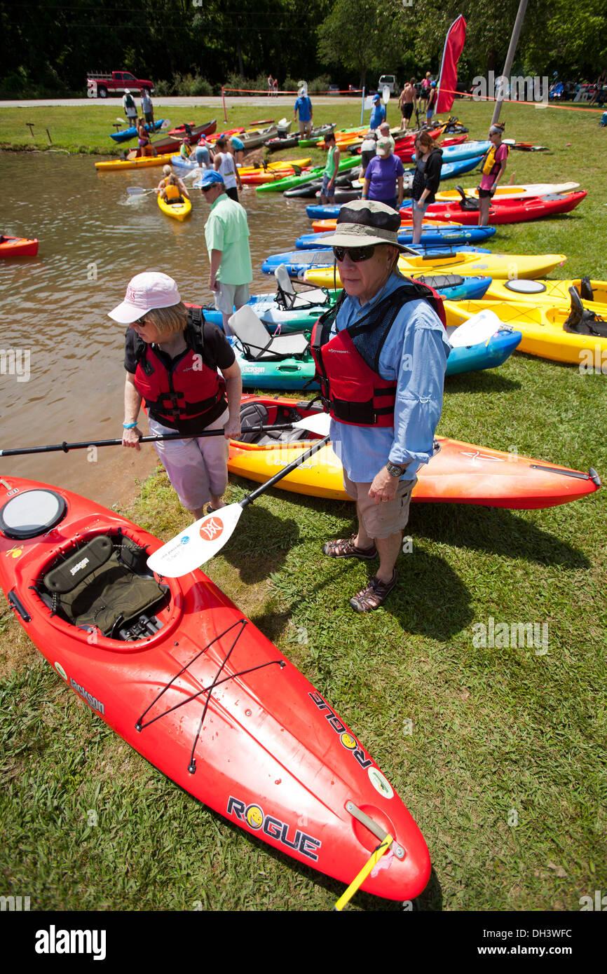 Two seniors attending a public kayaking event on a lake in Bella Vista, Arkansas, USA. Stock Photo