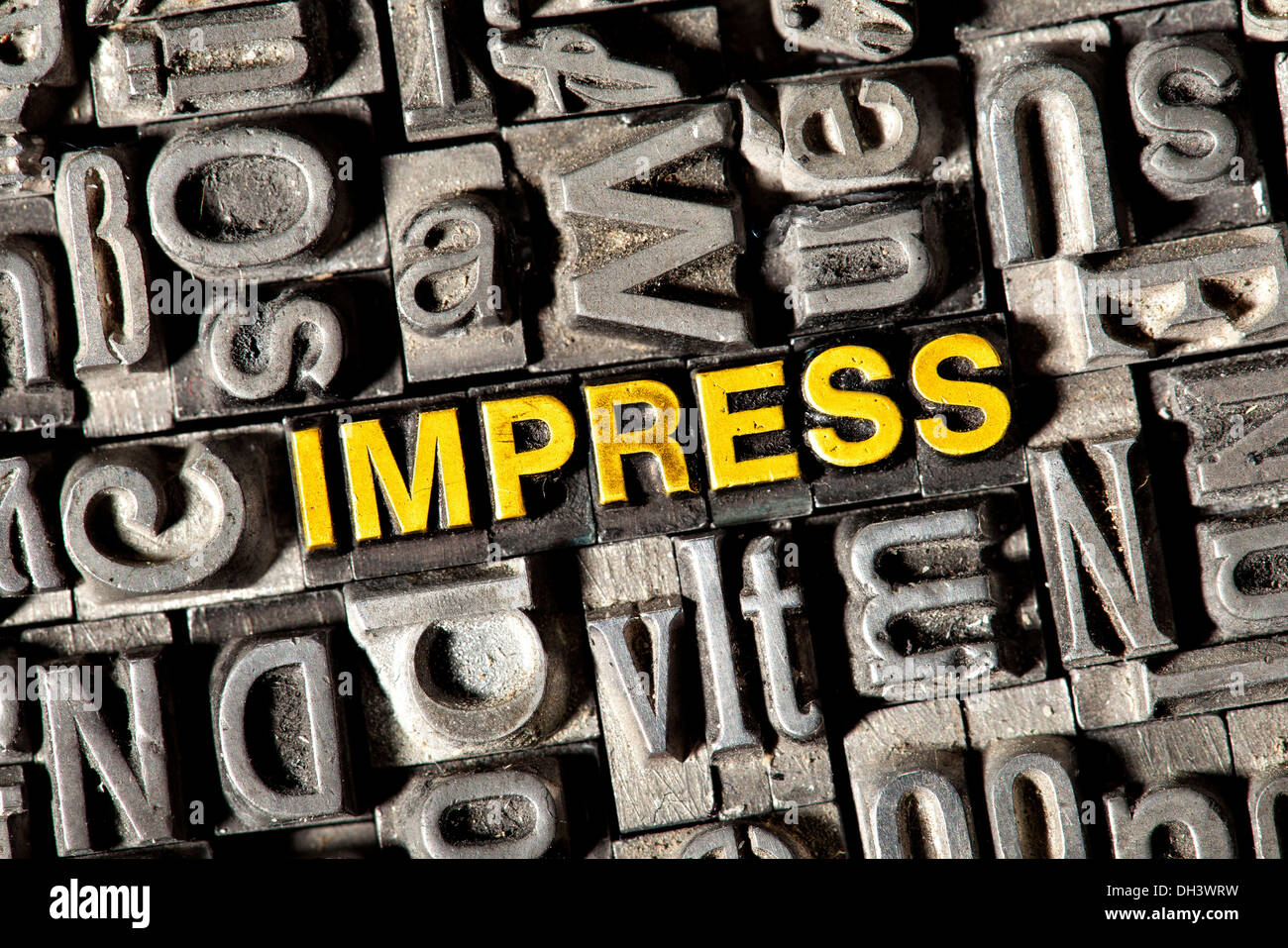 Old lead letters forming the word Impress - Stock Image