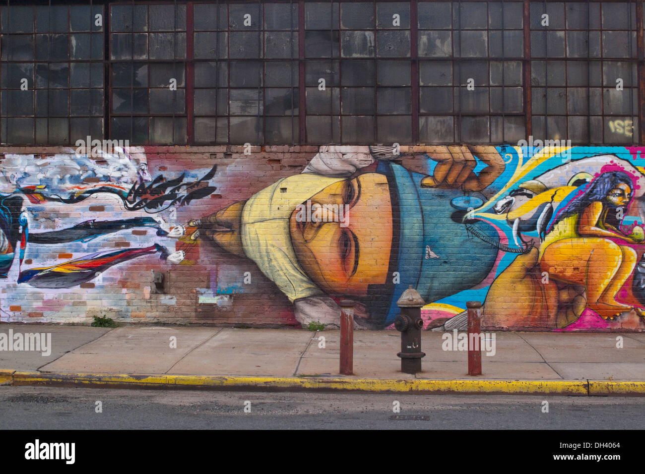 20 July 2010 -Brooklyn New York, Painted Mural on an industrial building in Greenpoint - Stock Image