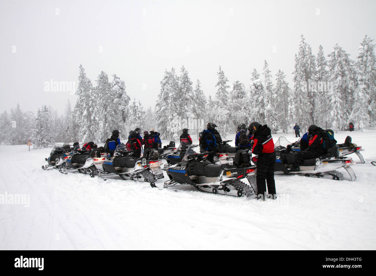 A group of travelles on snowmobiles - Stock Image