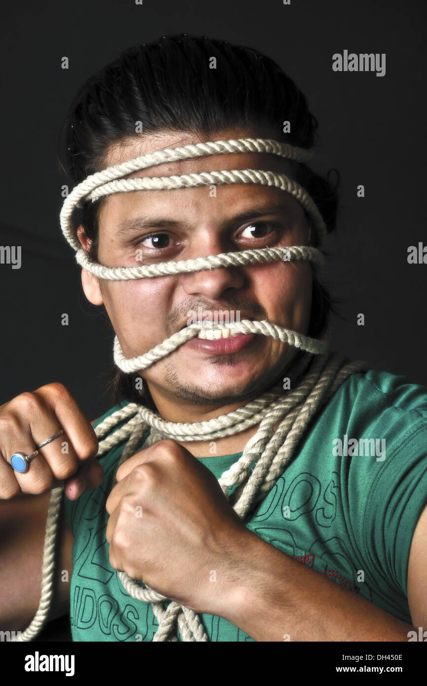 man tied with rope on face   MR#786 - Stock Image