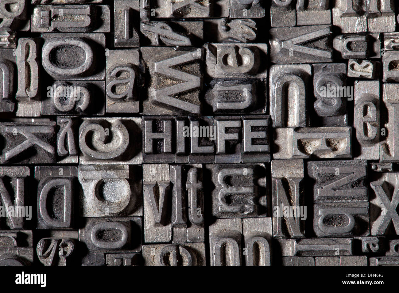 Old lead letters forming the word HILFE, German for help - Stock Image