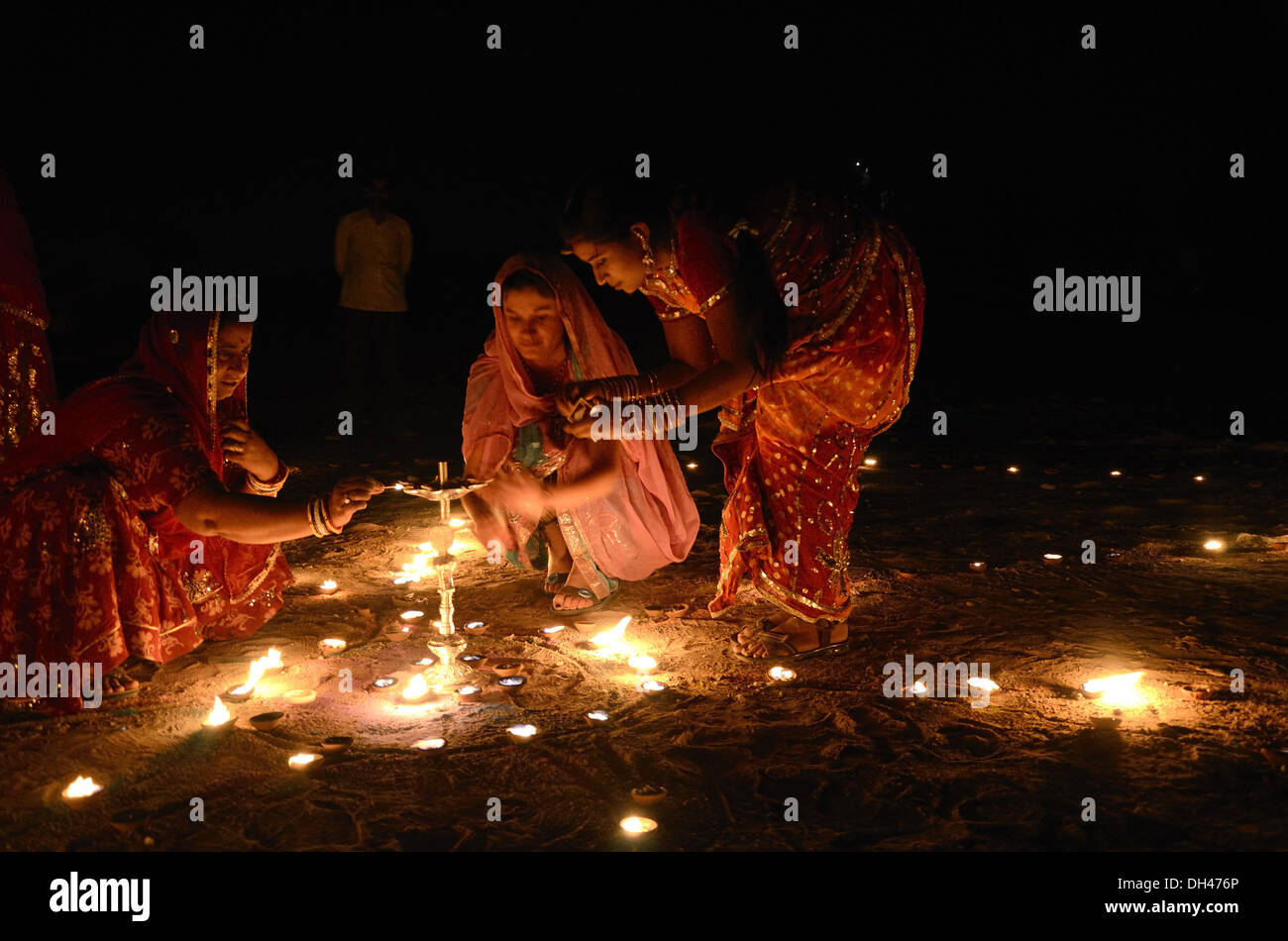 Indian women lighting lamps on Diwali festival of lights Jodhpur Rajasthan India - Stock Image
