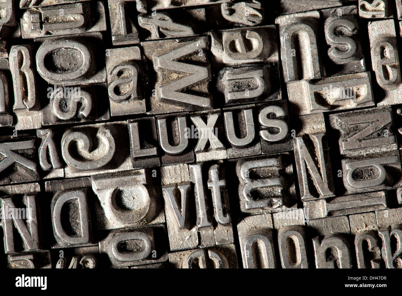 Old lead letters forming the word 'LUXUS', German for 'LUXURY' - Stock Image