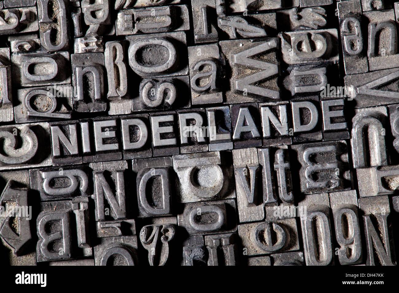 Old lead letters forming the word NIEDERLANDE, German for Netherlands - Stock Image