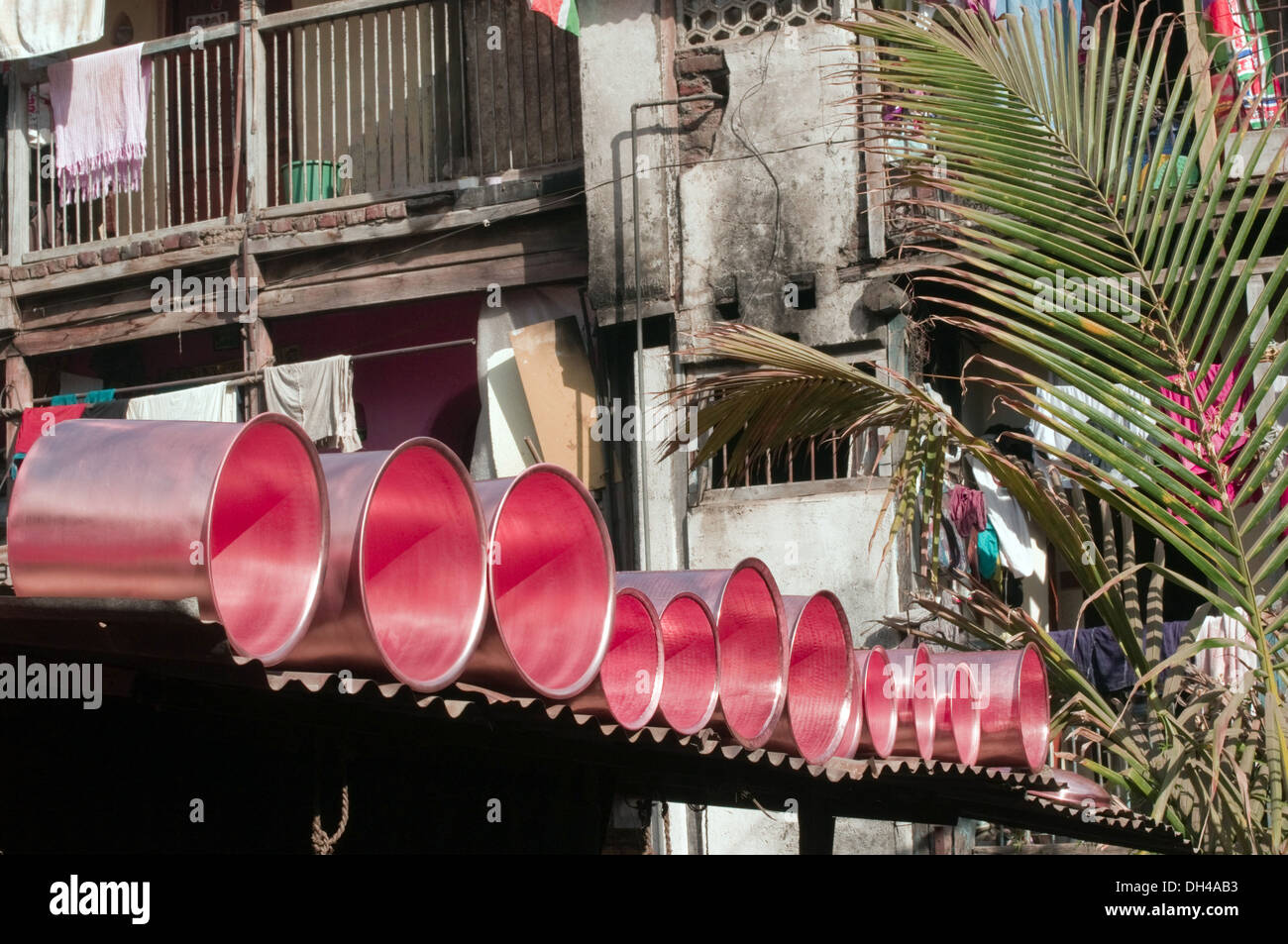 Copper vessels arranged over roof for baking Pune Maharashtra India Asia Feb 2012 - Stock Image