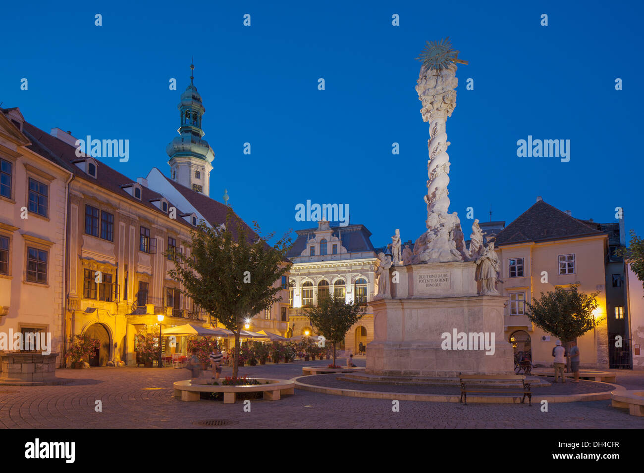 Firewatch Tower and Trinity Column in Main Square at dusk, Sopron, Western Transdanubia, Hungary - Stock Image