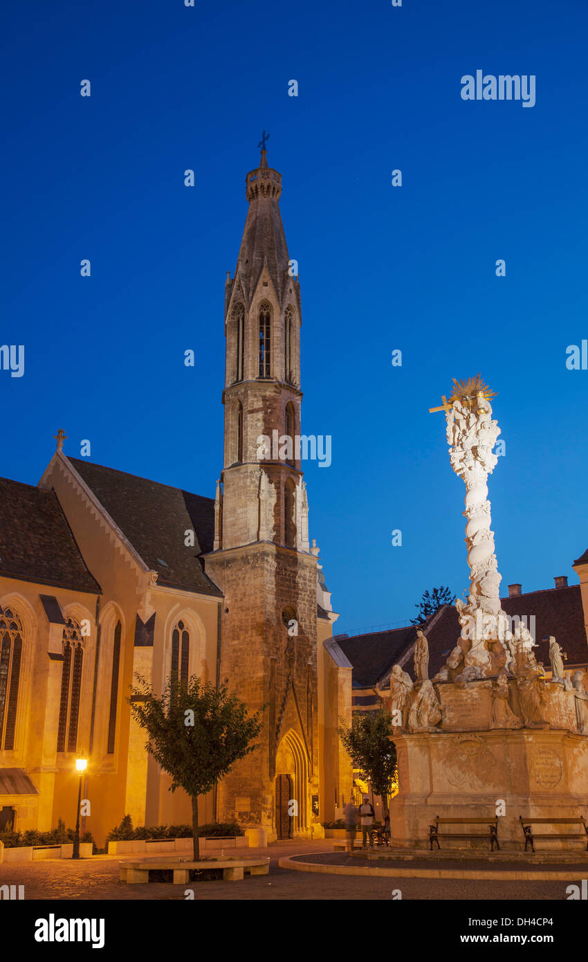 Goat Church and Trinity Column in Main Square at dusk, Sopron, Western Transdanubia, Hungary - Stock Image