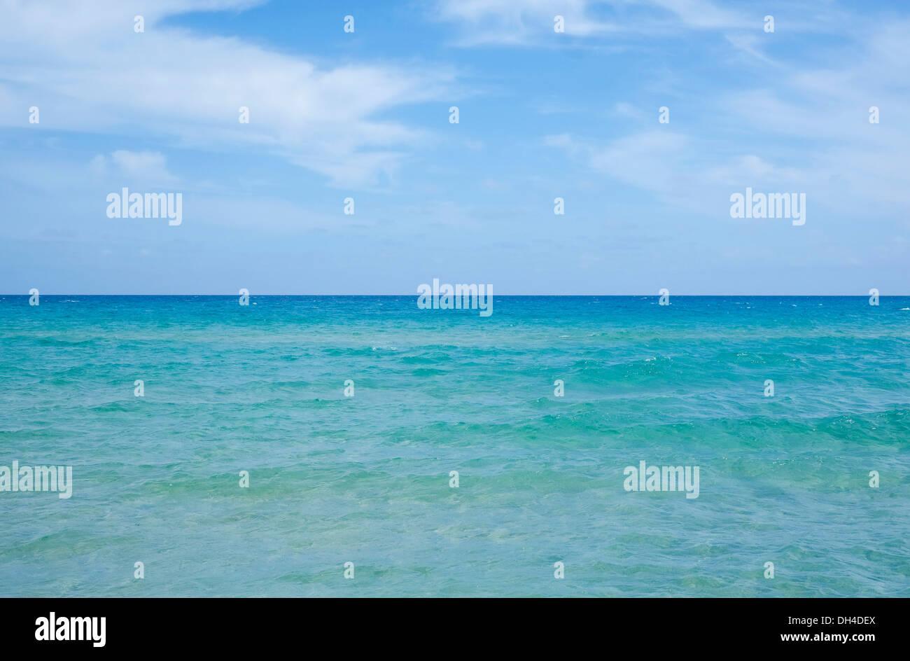 Sea and sky with sea horizon in Chia, Sardinia, Italy - Stock Image