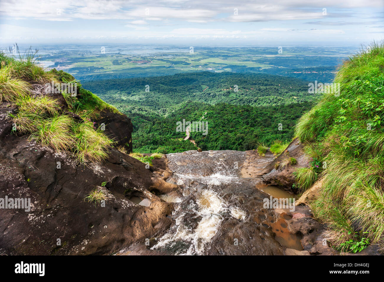 Waterfall over the Khasi Hill overlooking the road and forests of Bangladesh shot from near Cherrapunjee, India. - Stock Image