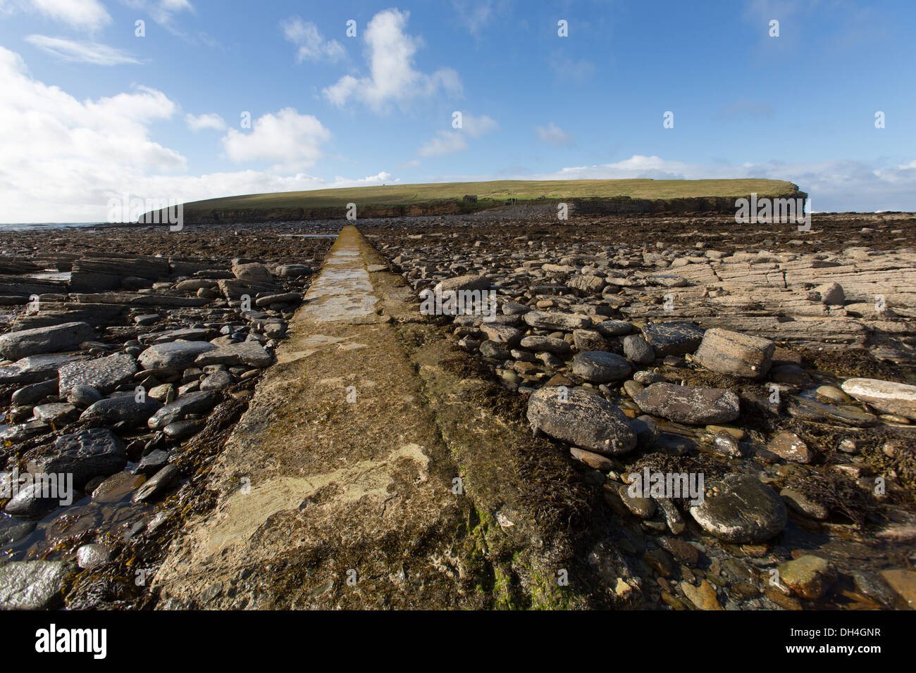 Islands of Orkney, Scotland. The causeway leading from Orkney's mainland to the tidal island Brough of Birsay. Stock Photo