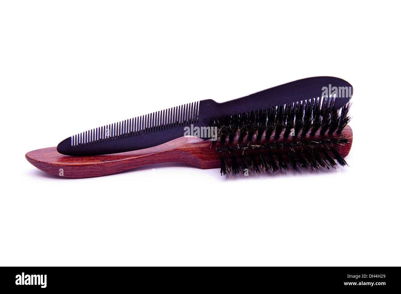 Hairbrush with comb - Stock Image