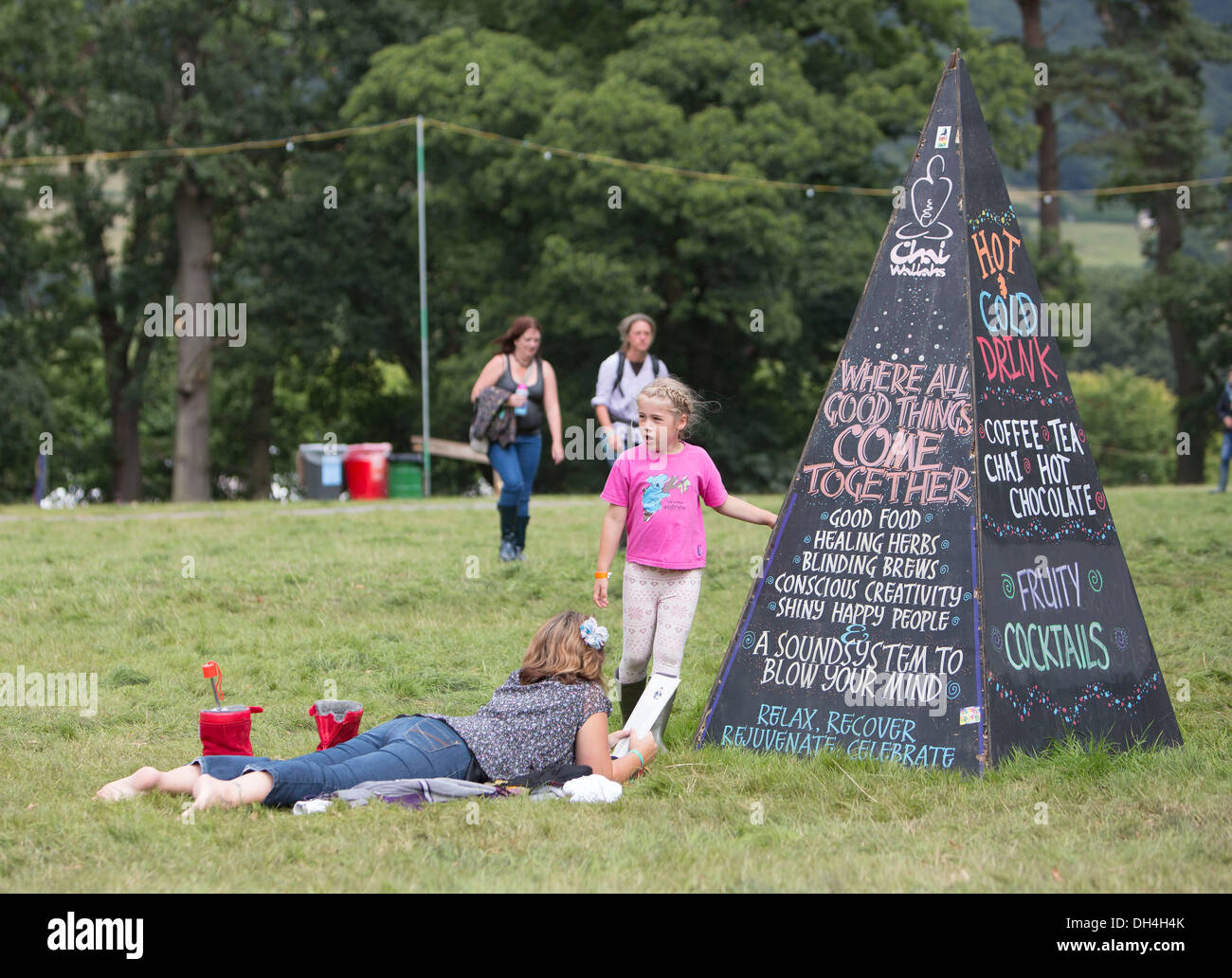 Festival goers take a well earned break at the Green Man Festival on the Glan Usk Estate, Crickhowell. - Stock Image