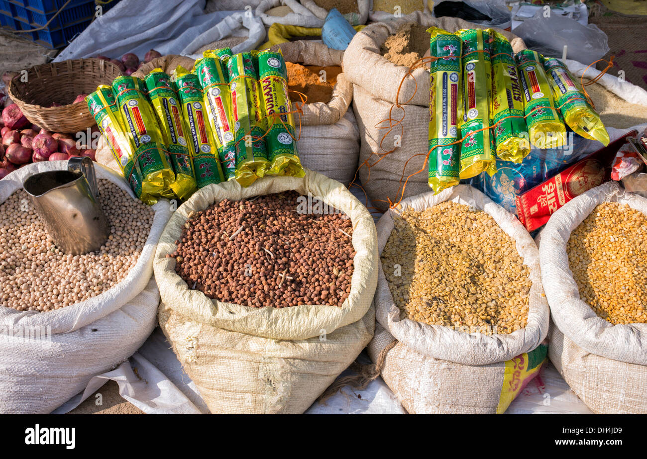 Sacks of dried food and incense for sale at an Indian market. Andhra Pradesh, India - Stock Image