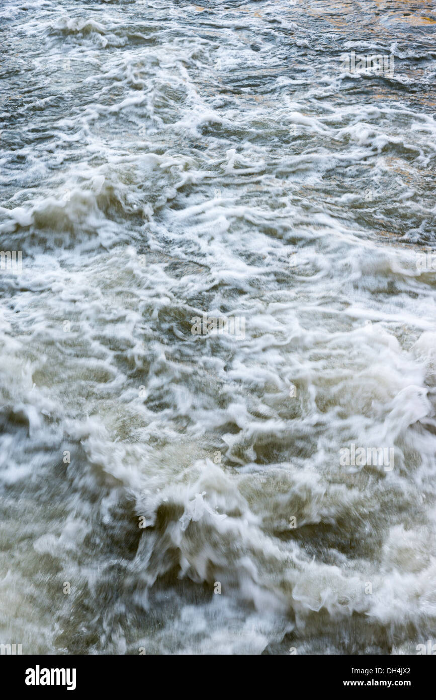 Gushing water in a river UK - Stock Image