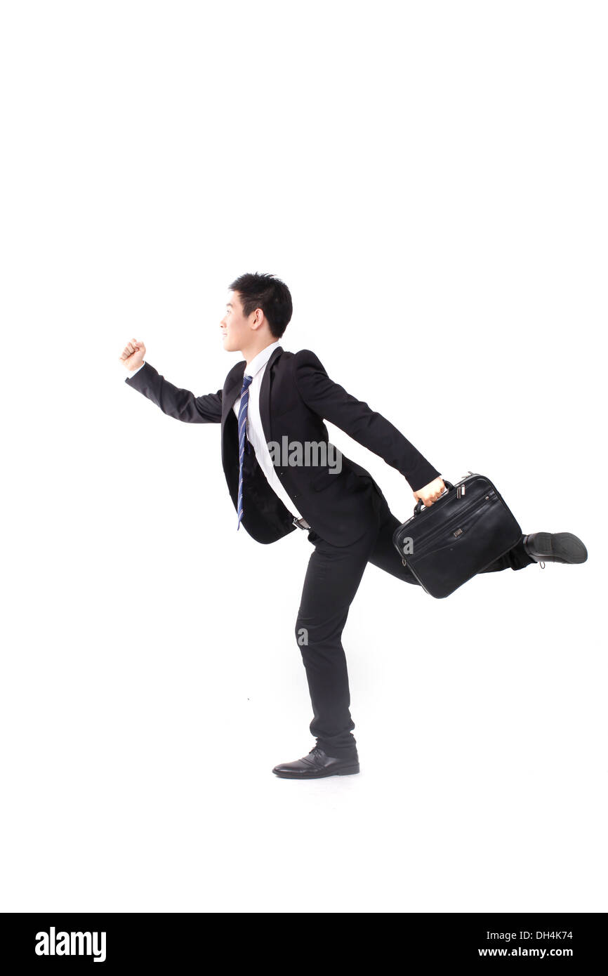 Young business man running swiftly - Stock Image