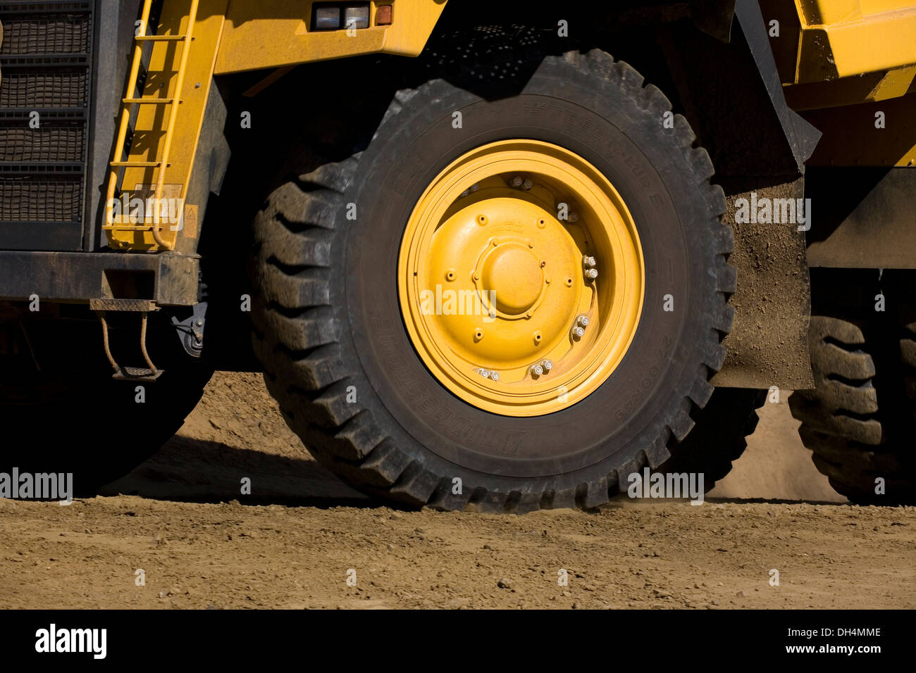 Close view of tire of one mine haul truck in pit - Stock Image