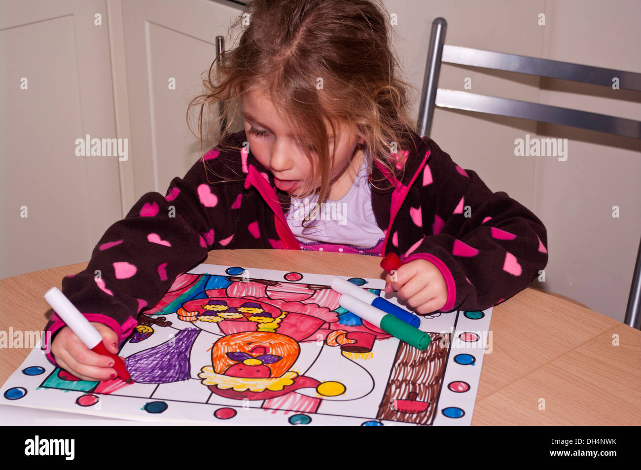 Child Colouring A Picture In A Colouring Book Stock Photo: 62185247 ...