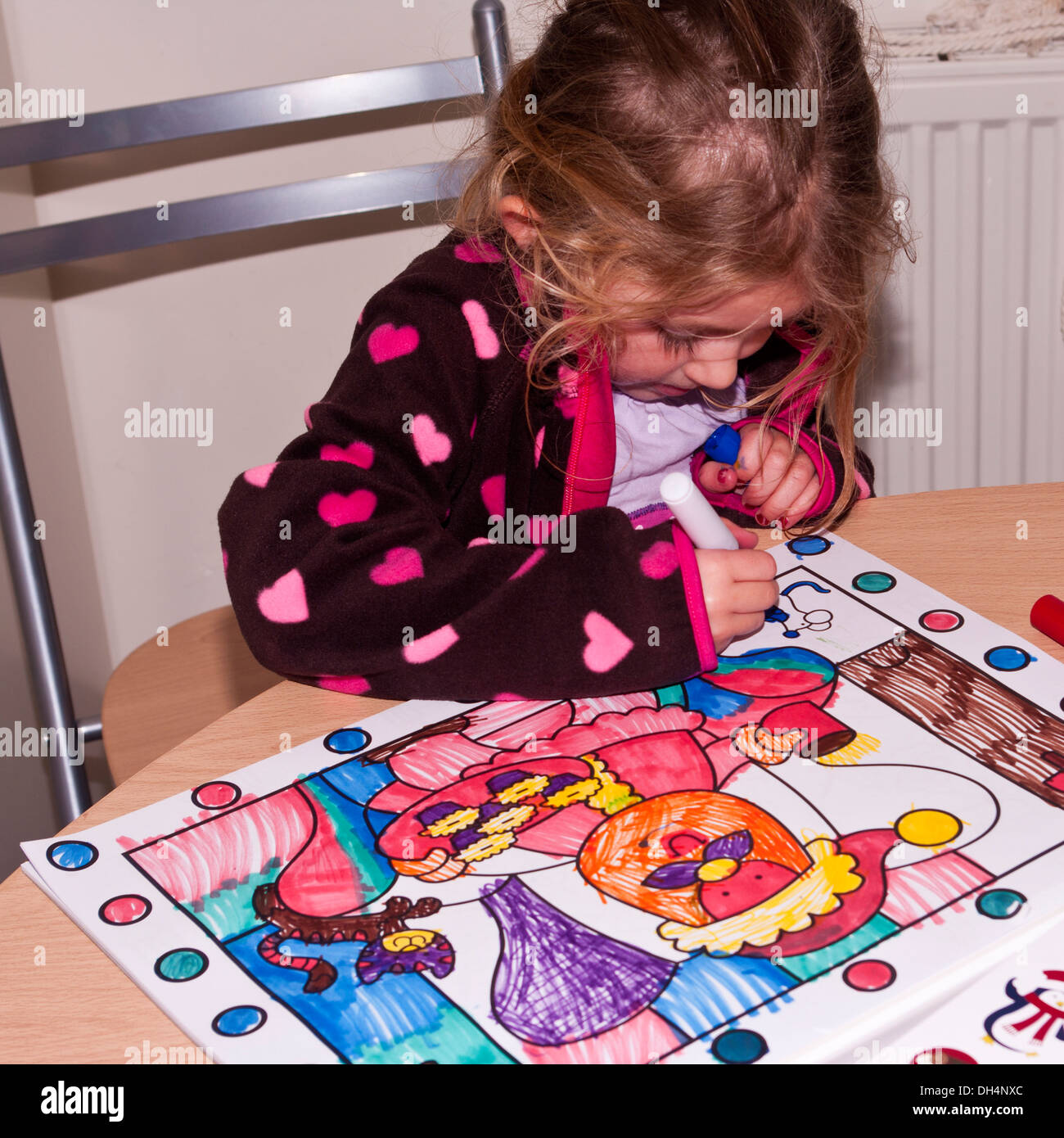 Little Girl Colouring A Picture In A Colouring Book Stock ...