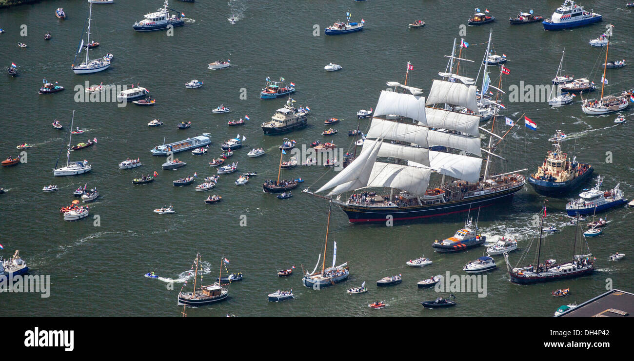 The Netherlands, Amsterdam, sailing event SAIL. Aerial of parade of tall ships. Big sailing boat called Clipper Stock Photo
