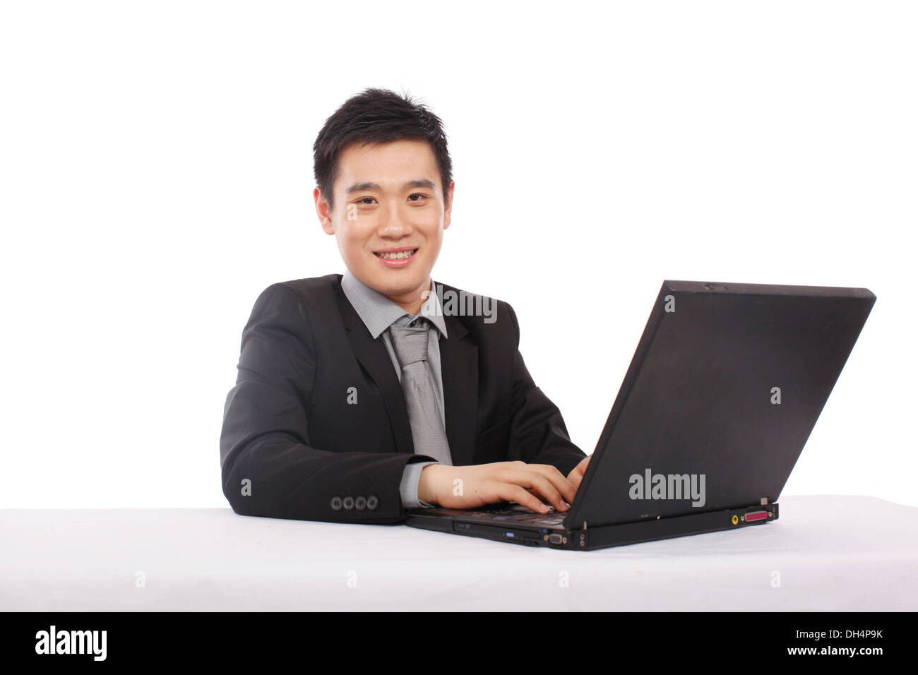 Asian Businessman using Laptop Compute Stock Photo