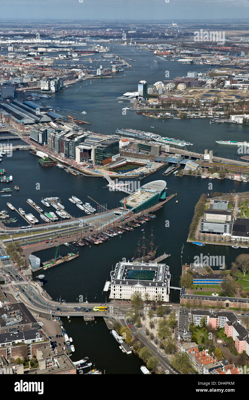 Netherlands, Amsterdam, View on IJ lake, Central Station, scientific museum NEMO and the National Maritime Museum. Aerial - Stock Image