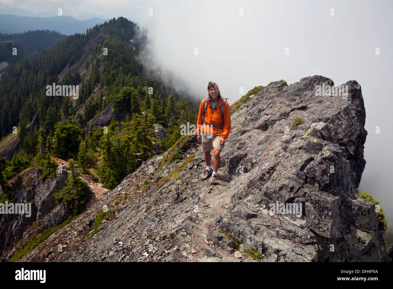 WASHINGTON - Hiker approaching along the edge of the fog towards summit of McClellan Butte on the I-90 Corridor. - Stock Image