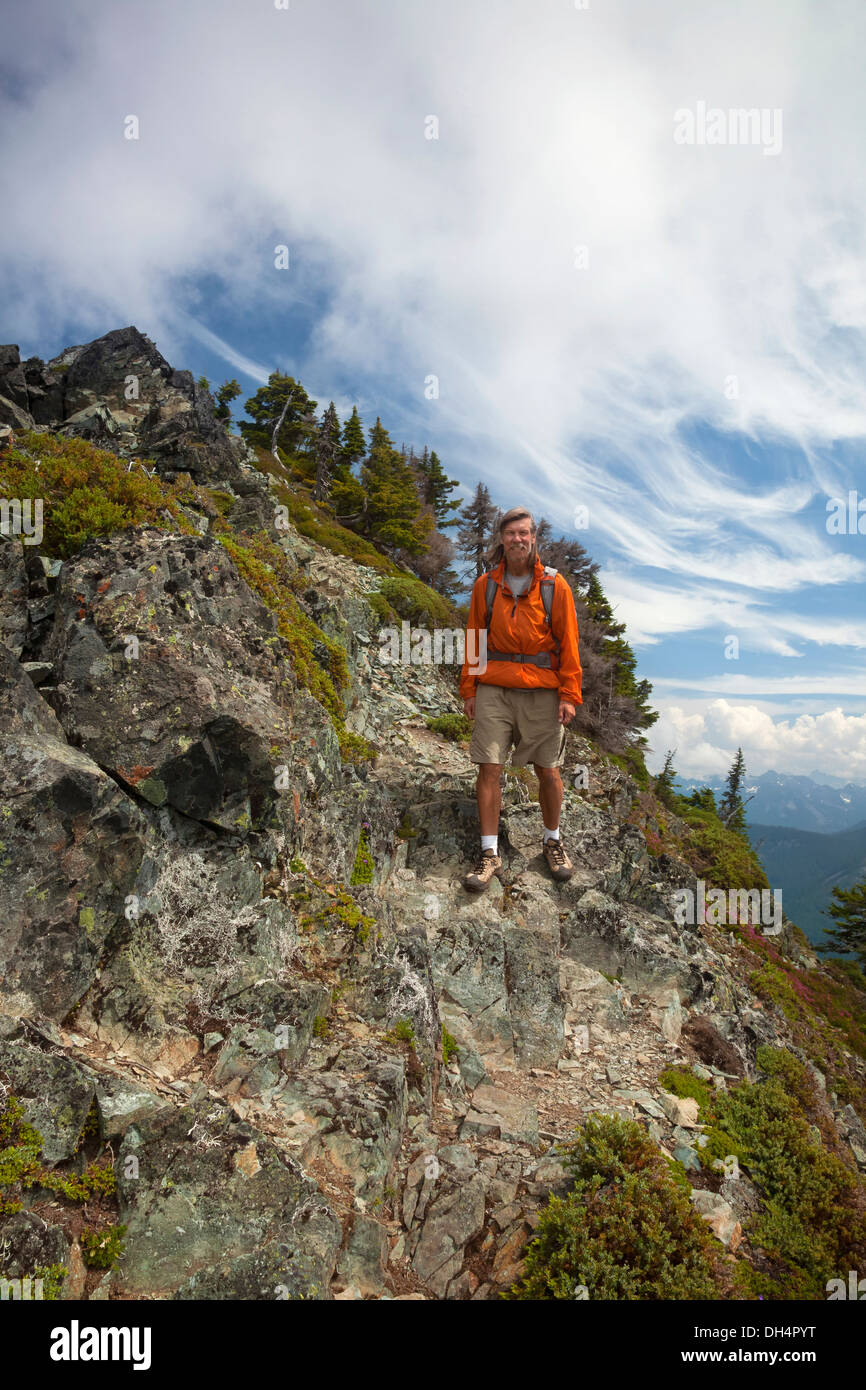 WASHINGTON - Hiker descending the trail off the rocky summit of McClellan Butte on the I-90 Corridor. - Stock Image