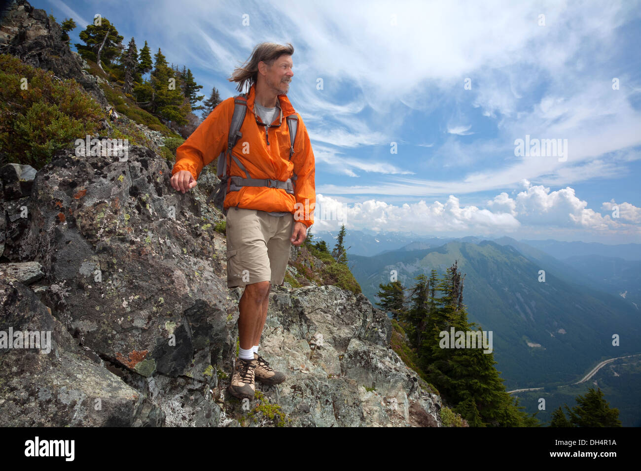 WASHINGTON - Hiker overlooking the Interstate 90 corridor from the trail near the rocky summit of McClellan Butte. - Stock Image