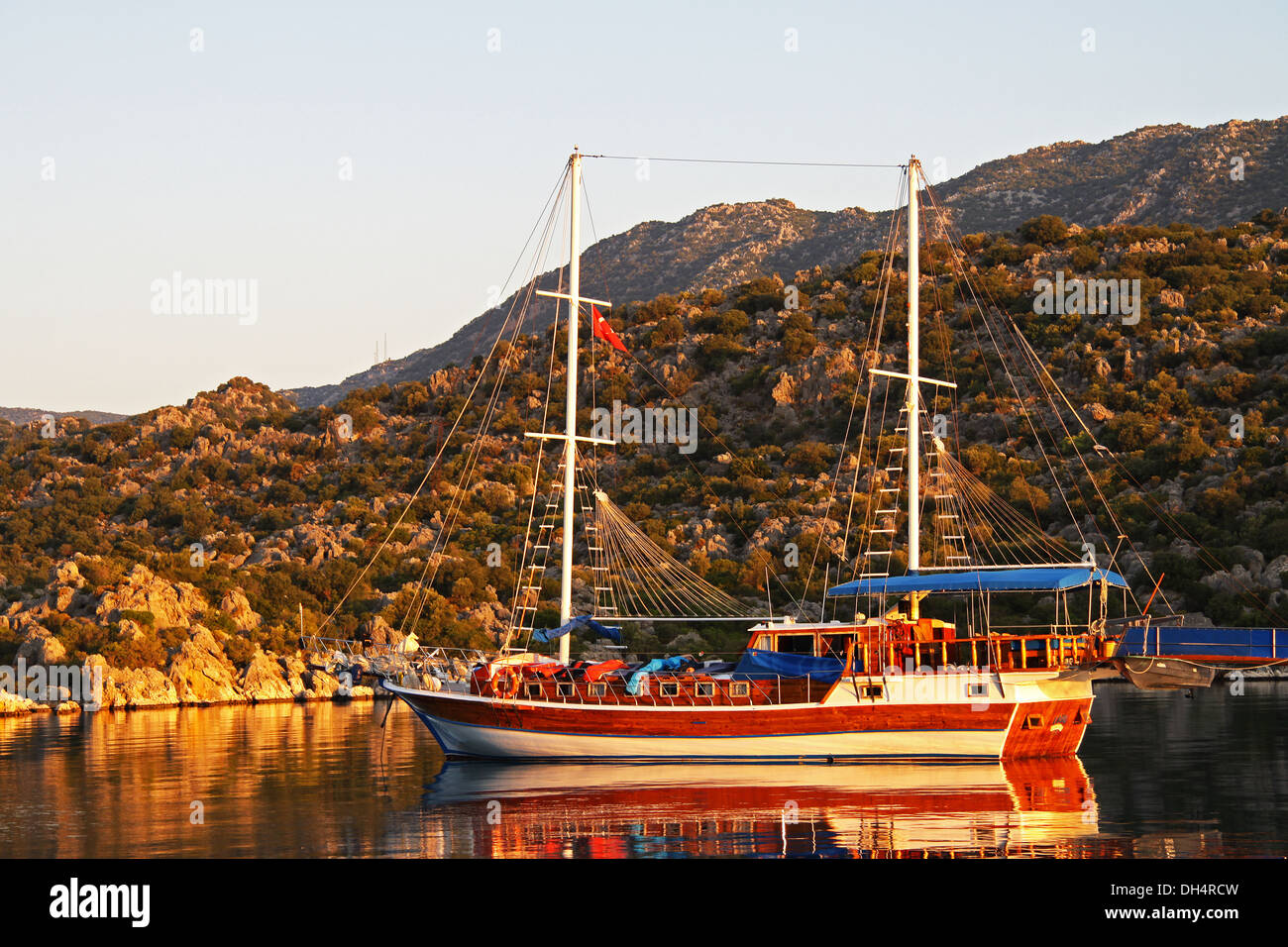 Colourfull boat in the Turkish sunset. - Stock Image