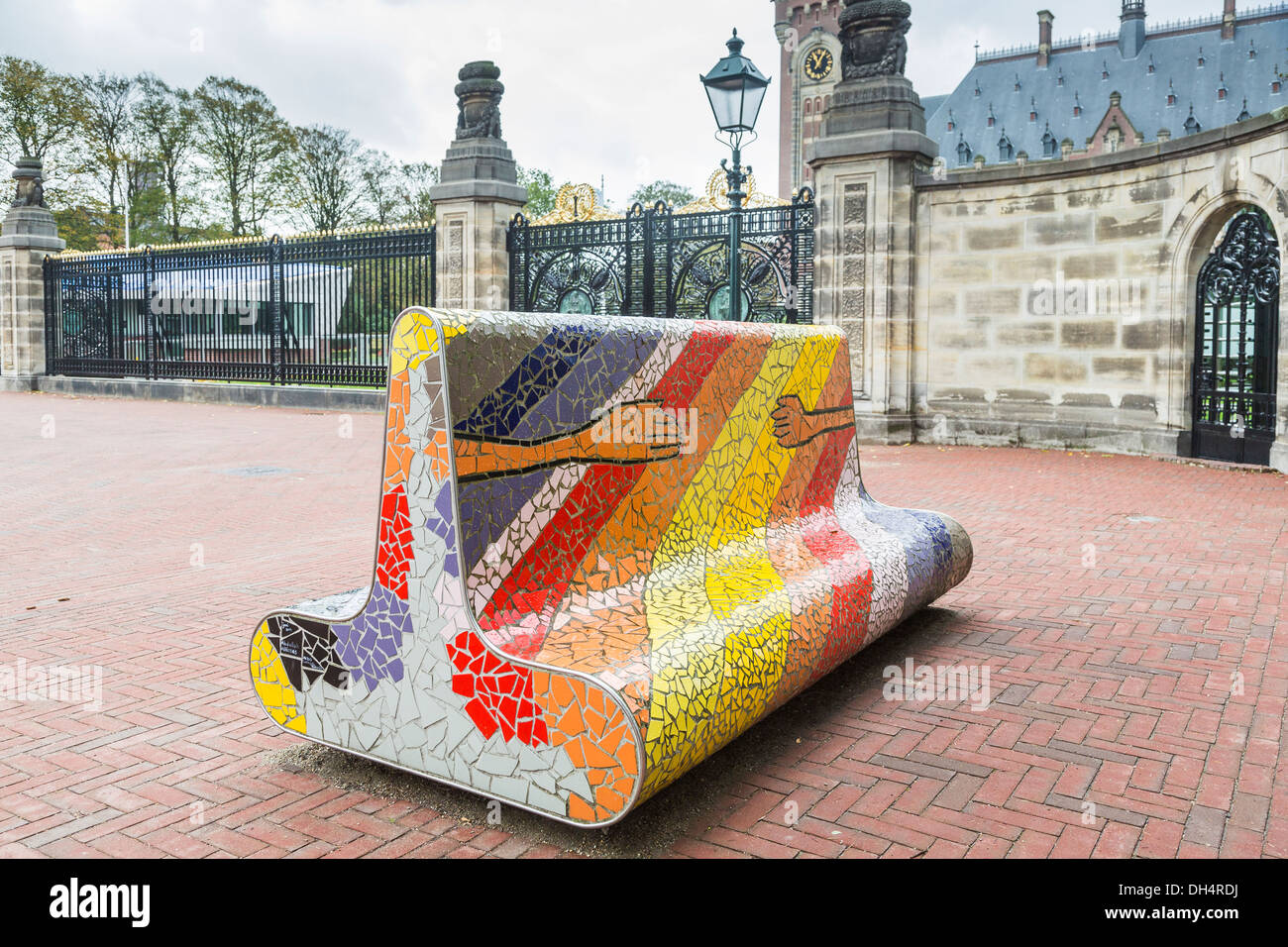 Brightly coloured mosaic stone bench seat symbolising friendship outside the Peace Palace, seat of International Court of Justice, The Hague, Holland - Stock Image