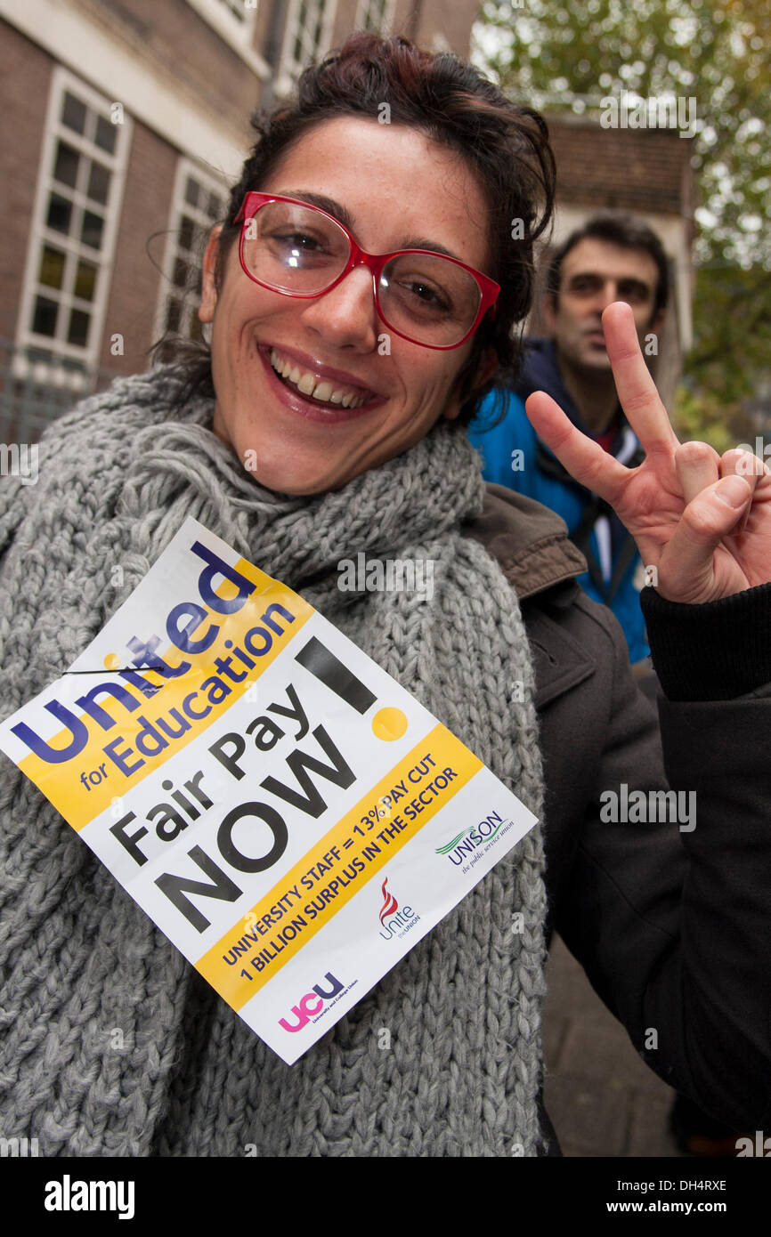 London, UK. 31st October 2013. A protester gives a 'V' sign as students support striking teaching and support staff to demand fairer wage increases and a living wage for low-paid university workers. Credit:  Paul Davey/Alamy Live News - Stock Image