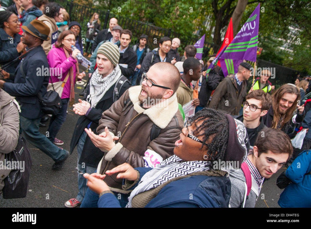 London, UK. 31st October 2013. Protesters sing at Red Lion Square as university staff and students, Unison, Unite and UCU  picketed and marched demanding fairer wage increases and a living wage for low-paid university support staff. Credit:  Paul Davey/Alamy Live News - Stock Image