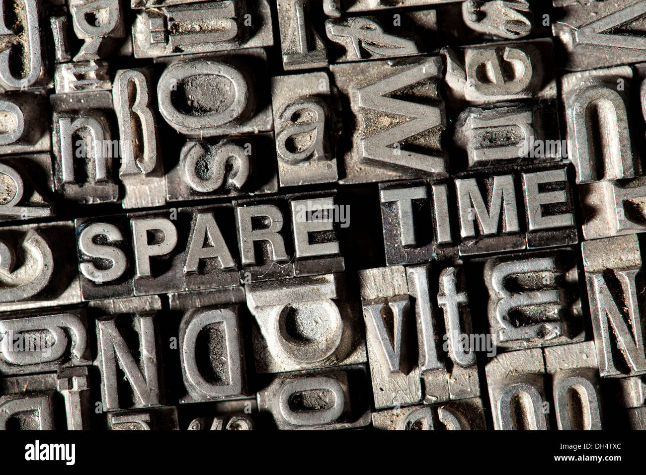 Old lead letters forming the term 'SPARE TIME' - Stock Image