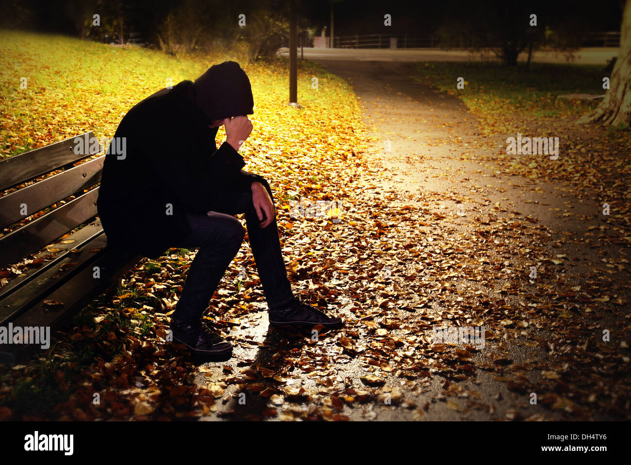 Depressed Man On Bench - Stock Image