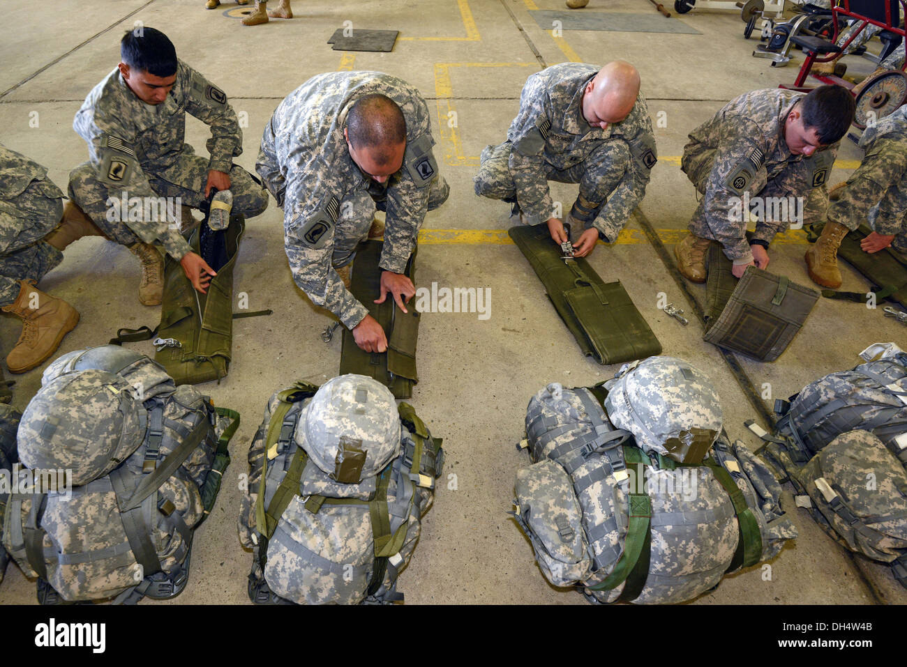 U.S. Army Soldiers, assigned to 173rd Infantry Brigade Combat Team (Airborne), prepare for a combat training jump Stock Photo
