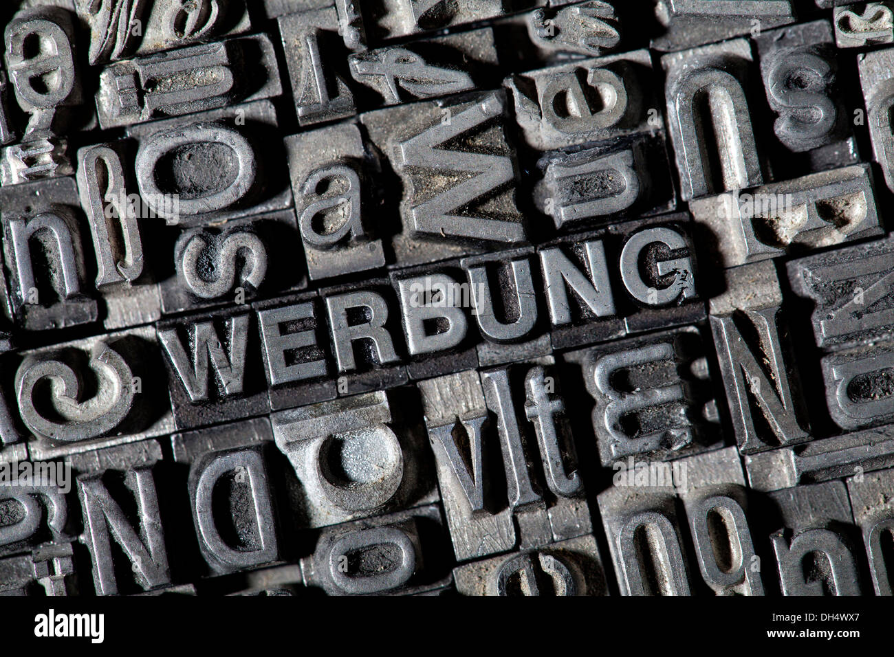Old lead letters forming the word WERBUNG, German for advertisement - Stock Image
