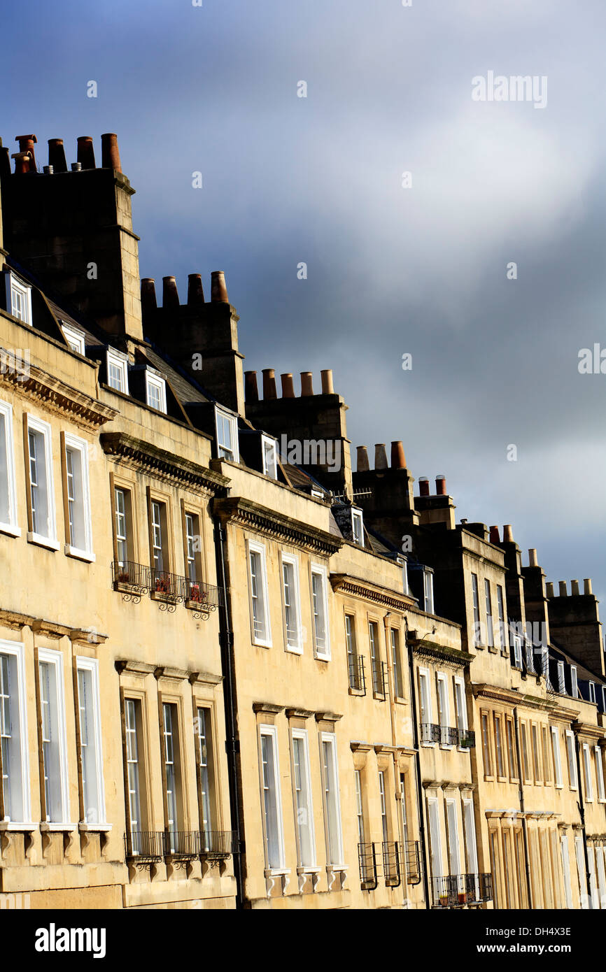 Top section of a row of houses in a Georgian Terrace in Bath, UK. - Stock Image