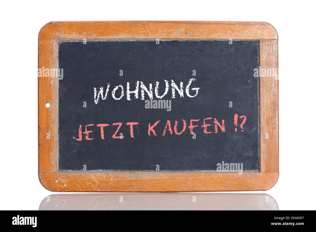 Old school blackboard with the words WOHNUNG JETZT KAUFEN!?, German for Buy an apartment now!? - Stock Image