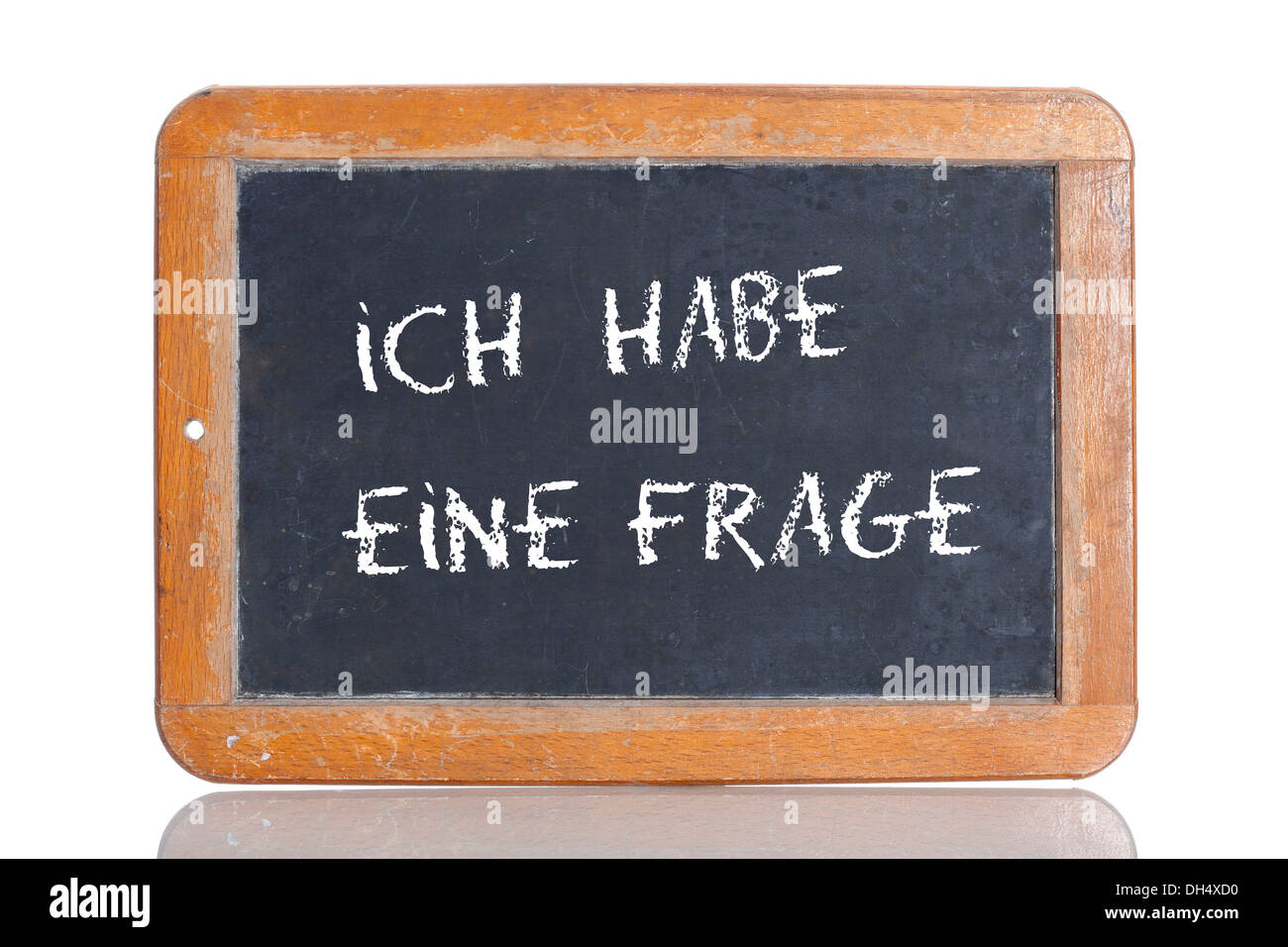 Old school blackboard with the words ICH HABE EINE FRAGE, German for I have a question - Stock Image