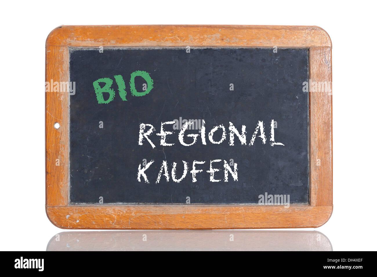 Old school blackboard with the words BIO REGIONAL KAUFEN, German for Organic - Buy local - Stock Image