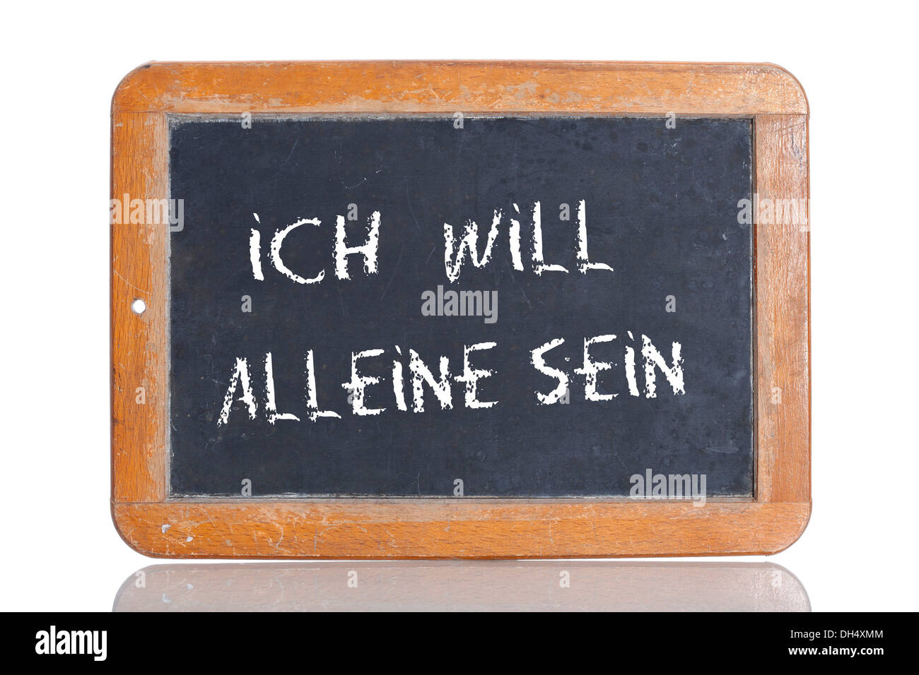 Old school blackboard with the words ICH WILL ALLEINE SEIN, German for I want to be alone - Stock Image