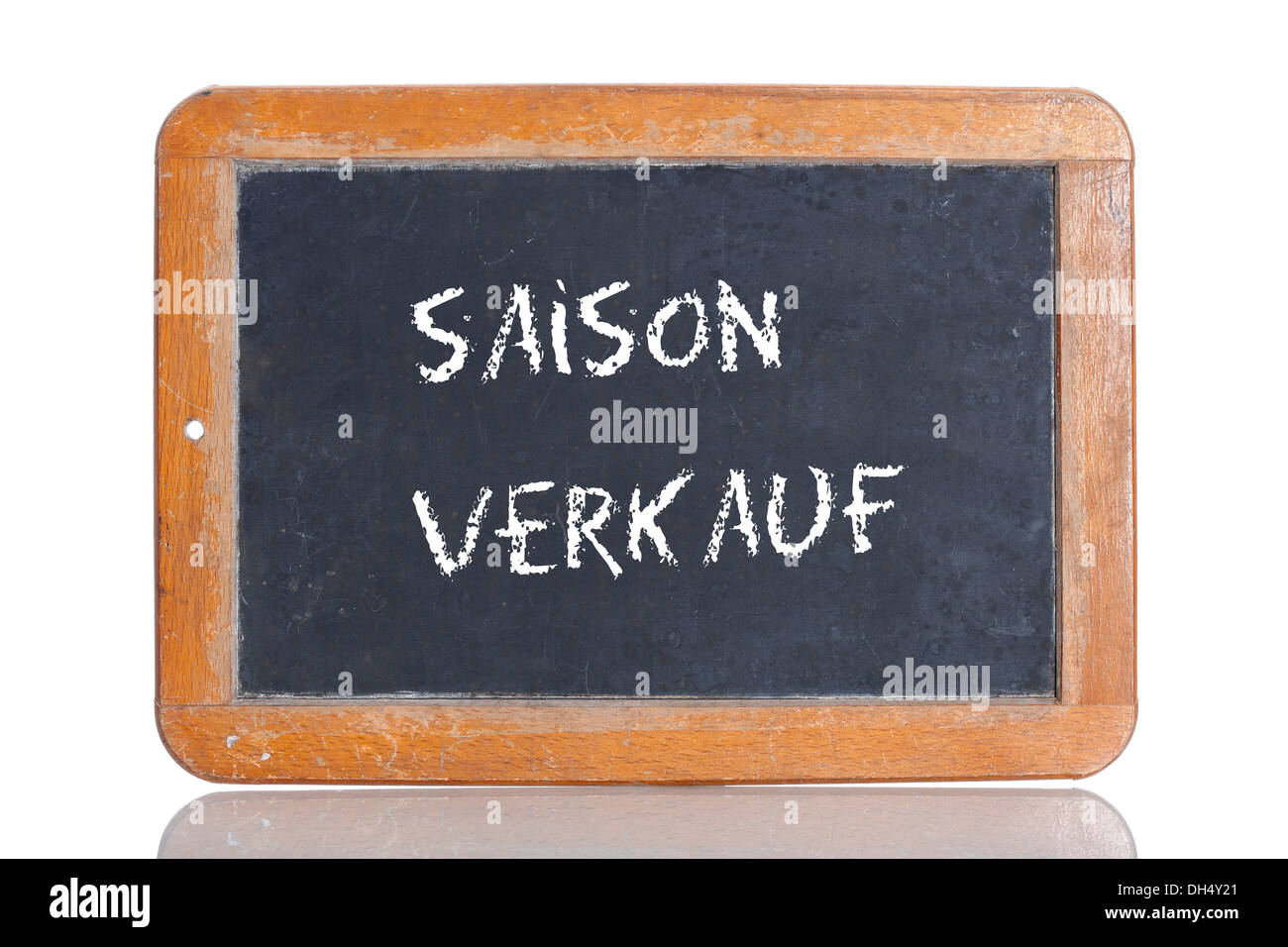 Old school blackboard with the words SAISON VERKAUF, German for Seasonal sale - Stock Image
