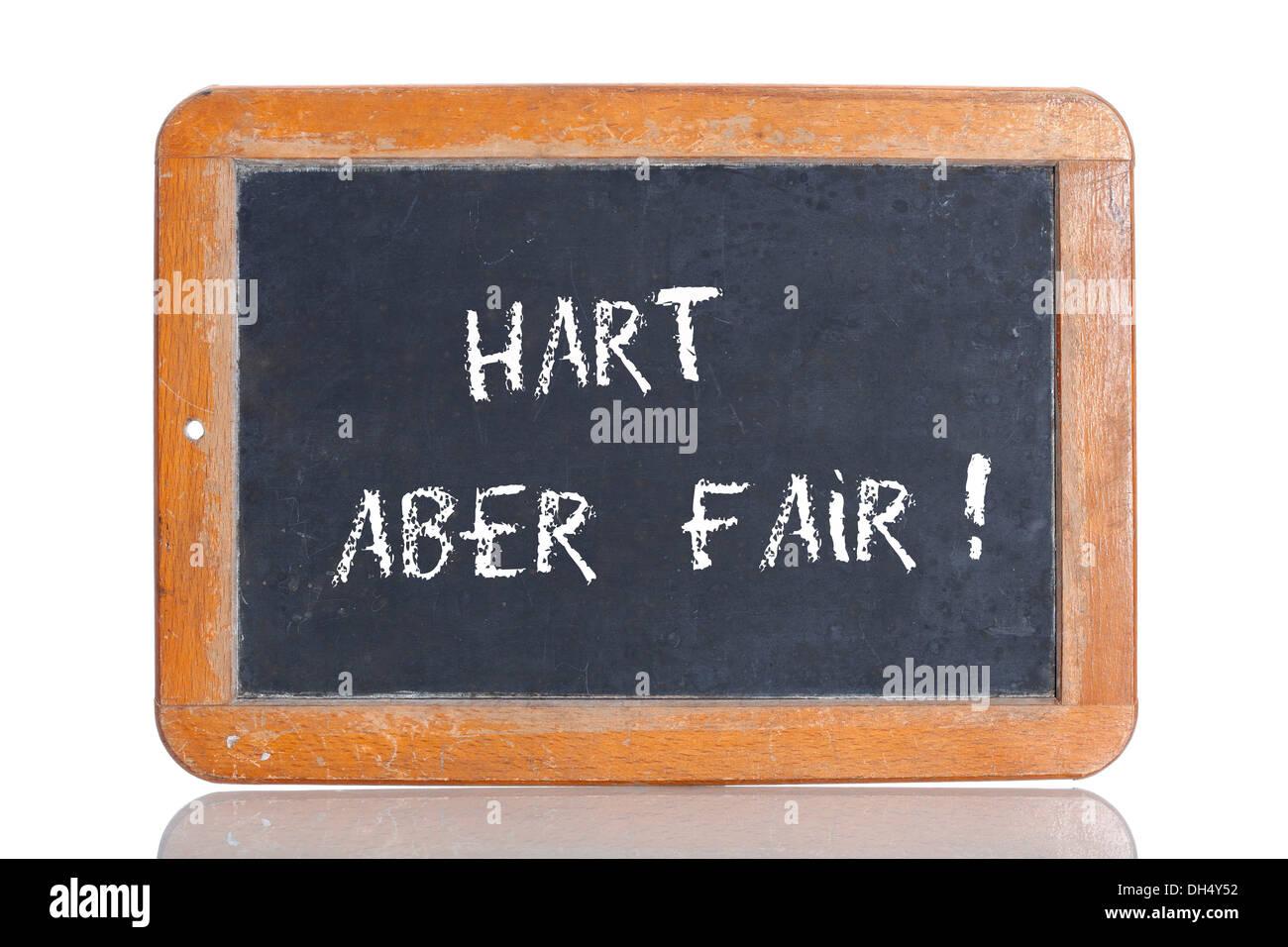 Old school blackboard with the term HART ABER FAIR, German for hard but fair - Stock Image