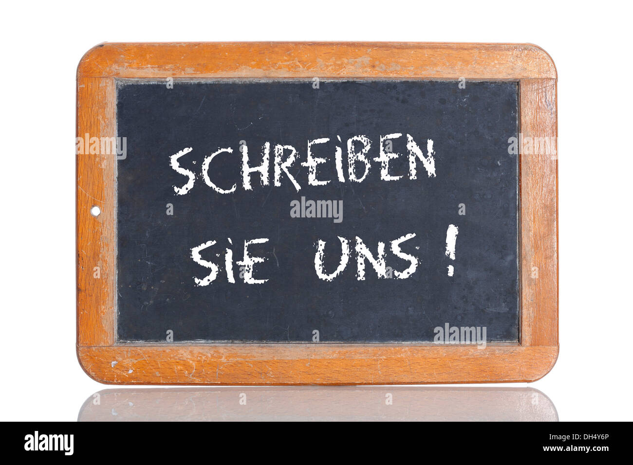 Old school blackboard with the term SCHREIBEN SIE UNS, German for write to us - Stock Image