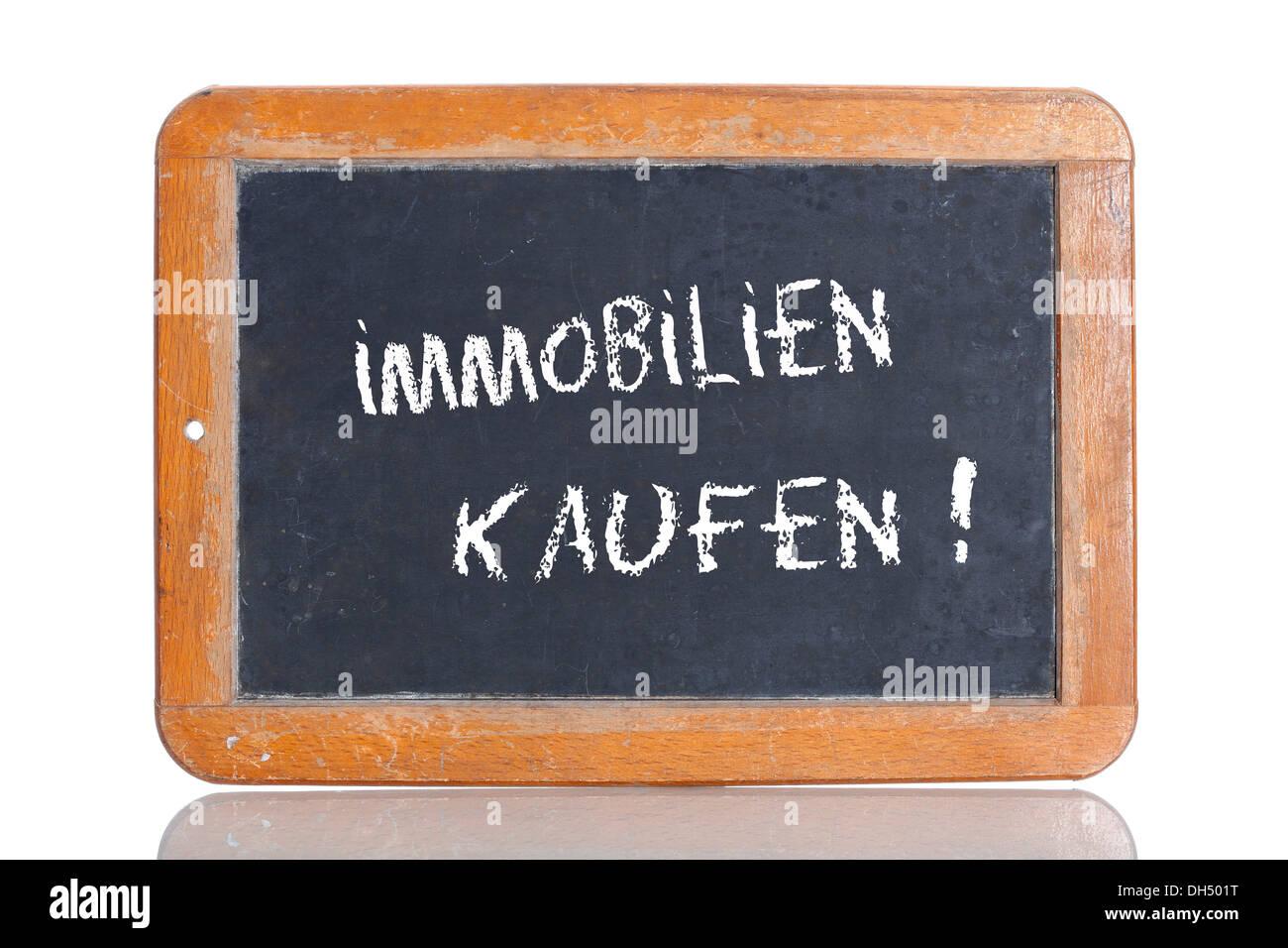 Old chalkboard, lettering 'IMMOBILIEN KAUFEN', German for 'BUY PROPERTY' - Stock Image